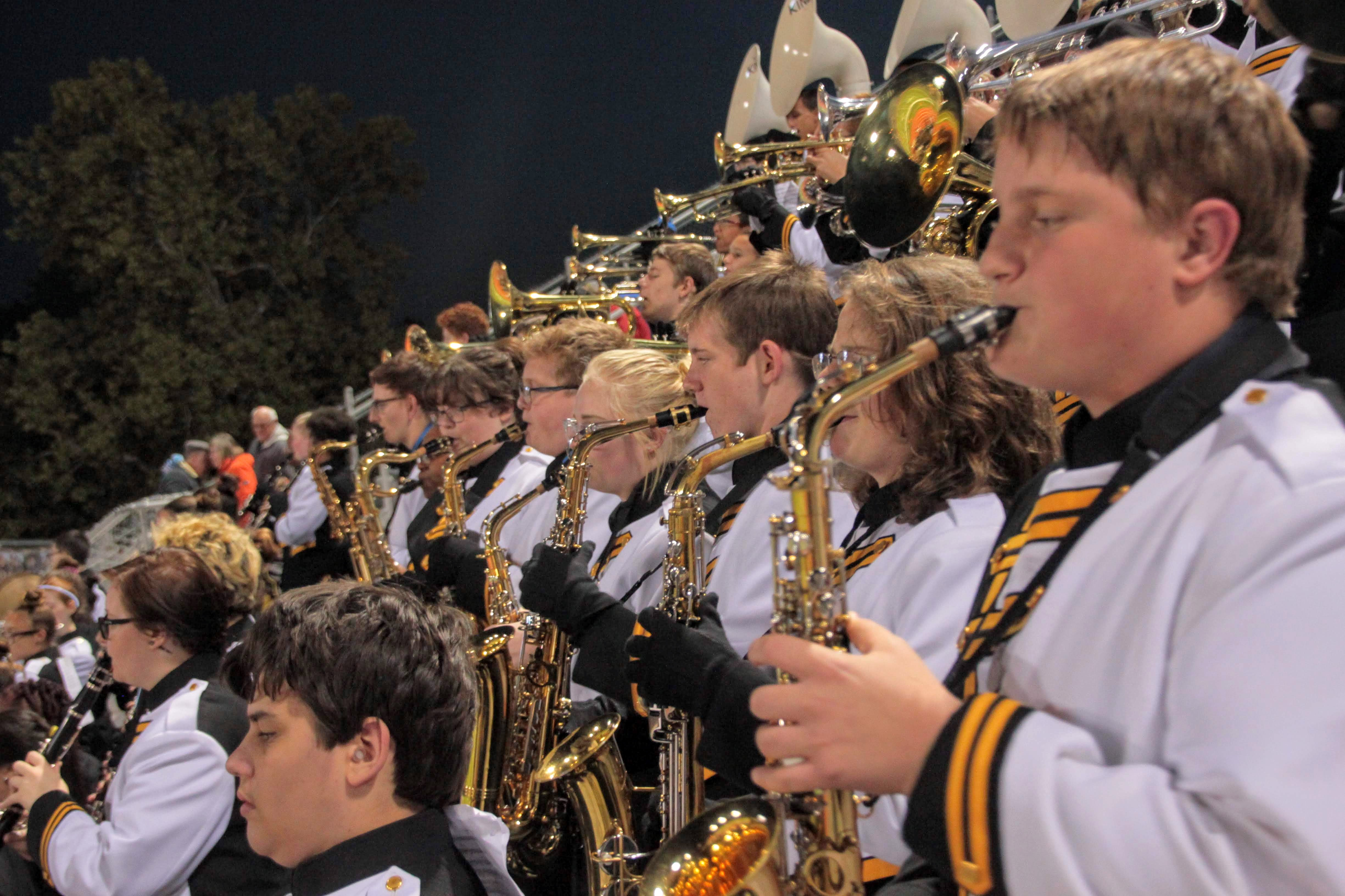 Shawnee Mission West Pride Band playing at a football game